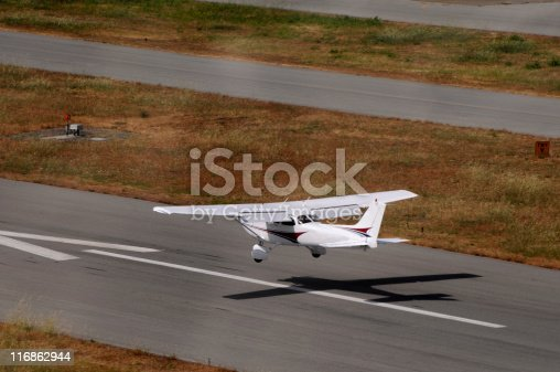 Private airplane landing. Viewed from behind and above. Cessna 172.