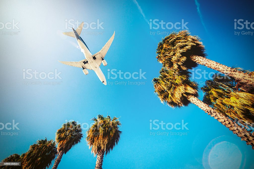 Airplane landing in Los Angeles Airport stock photo