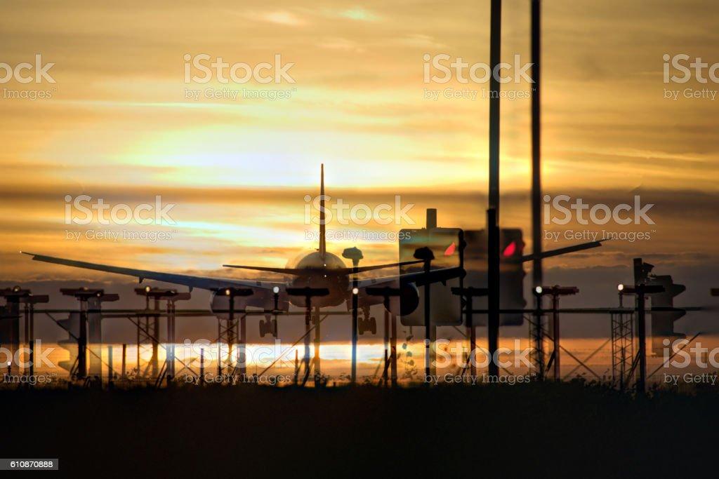 Airplane landing in sunset double exposure stock photo