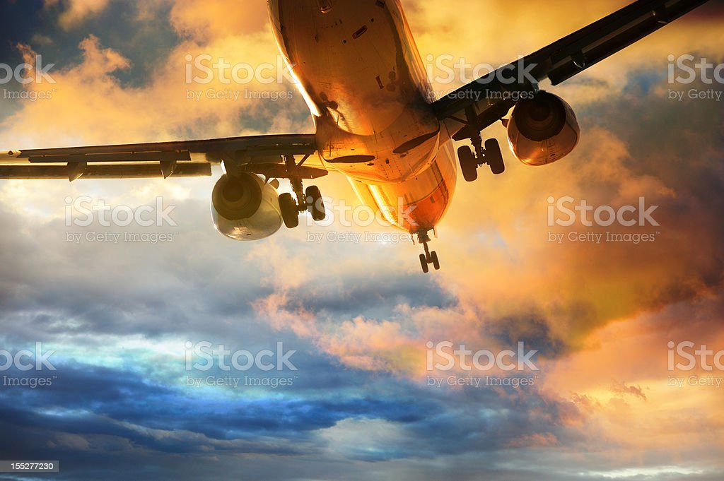 Airplane landing in the evening stock photo