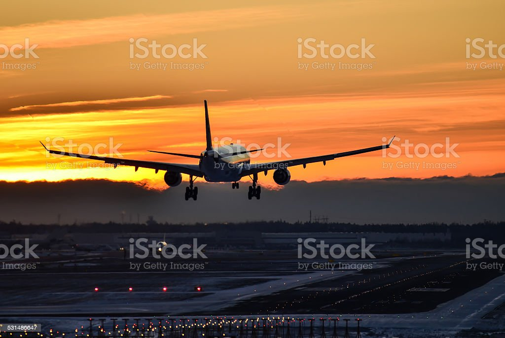 Airplane landing late evening stock photo