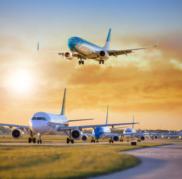 Airplane landing others standing on airfield waiting for take off stock photo