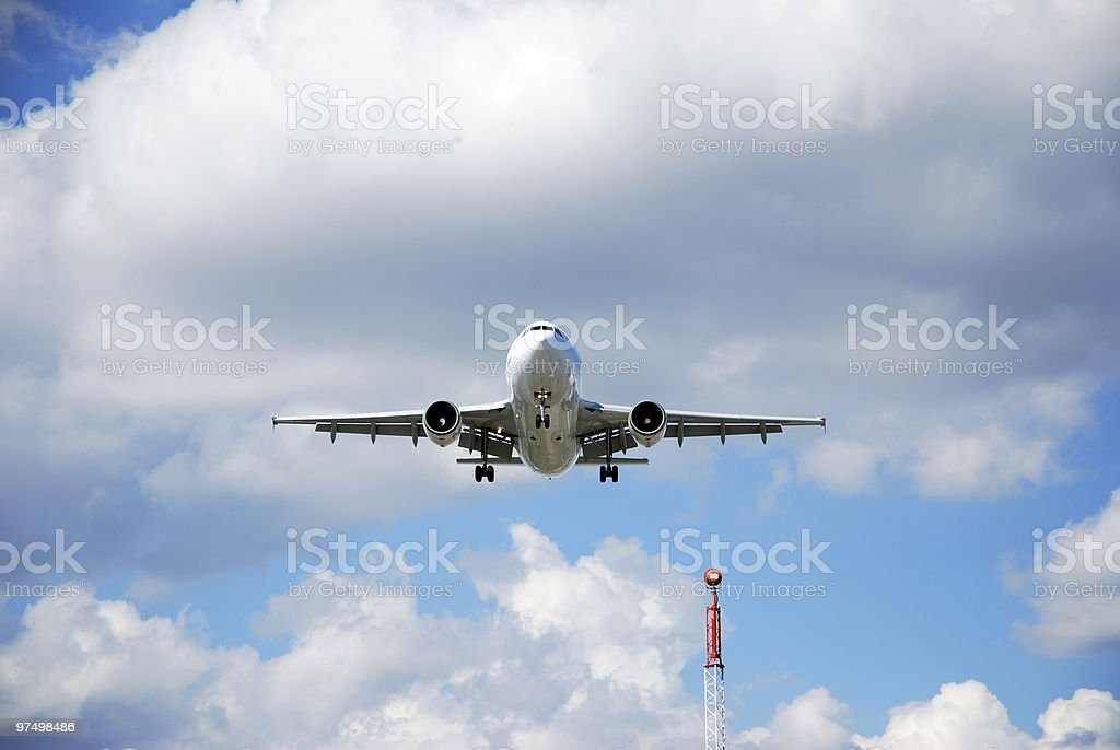 Airplane landing royalty-free stock photo