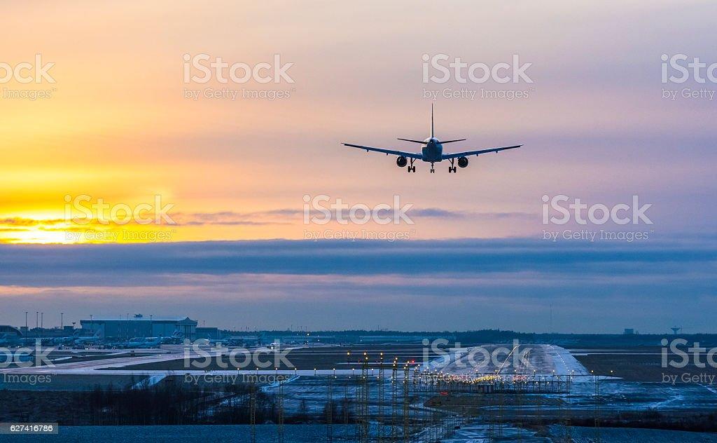 Airplane landing to airport runway stock photo