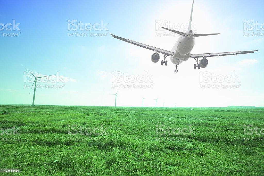 airplane landing with green grassland stock photo