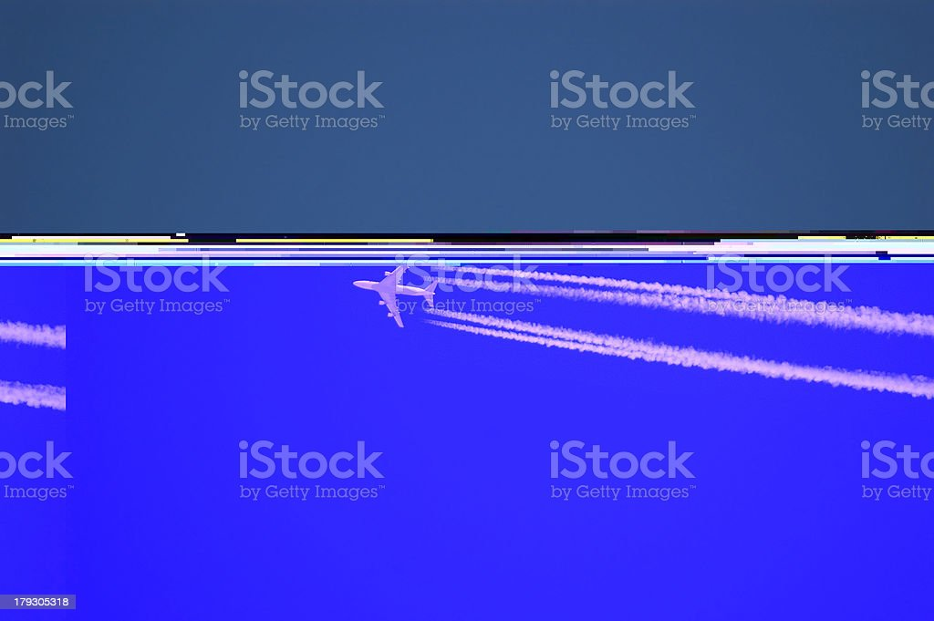 Airplane leaving a vapor trail shot from low ground royalty-free stock photo