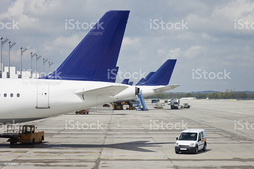 Airplane loading on airport royalty-free stock photo