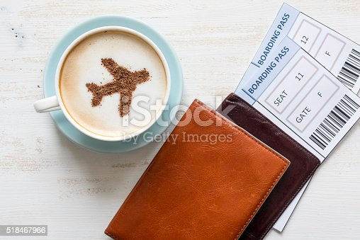 istock Airplane made of cinnamon in cappuccino and boarding passes. 518467966