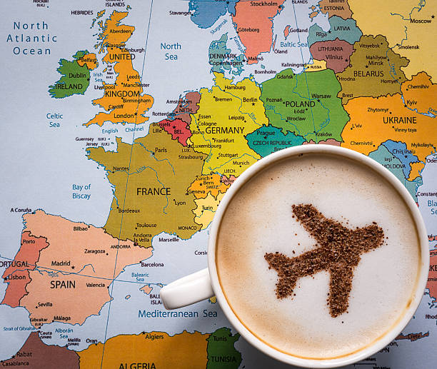 Airplane made of cinnamon in cappuccino and Europe map stock photo