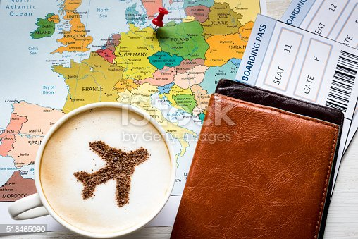 istock Airplane made of cinnamon in cappuccino, Passports and Europe map 518465090