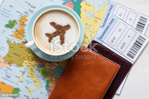 istock Airplane made of cinnamon in cappuccino, Passports and Europe map 518465302