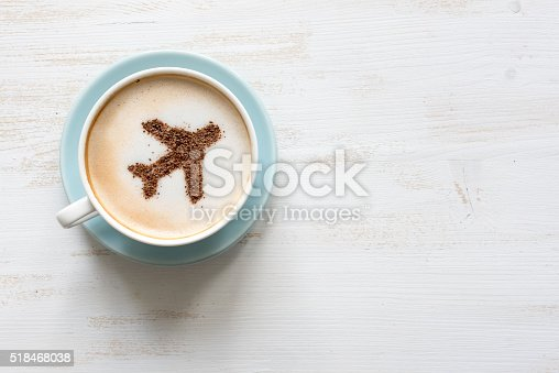 istock Airplane made of cinnamon in cappuccino , white background 518468038