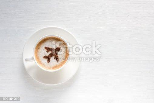 istock Airplane made of cinnamon in coffee 590154010