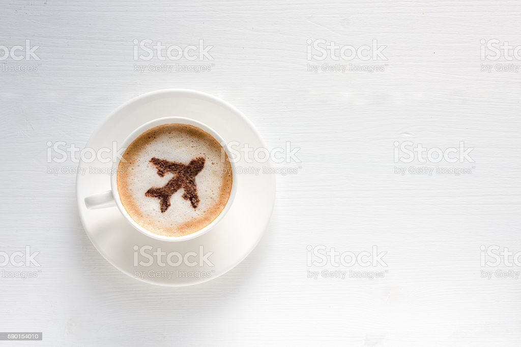 Airplane made of cinnamon in coffee stock photo