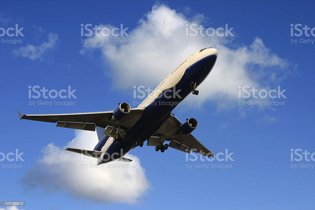 Airplane MD11 and blue sky royalty-free stock photo