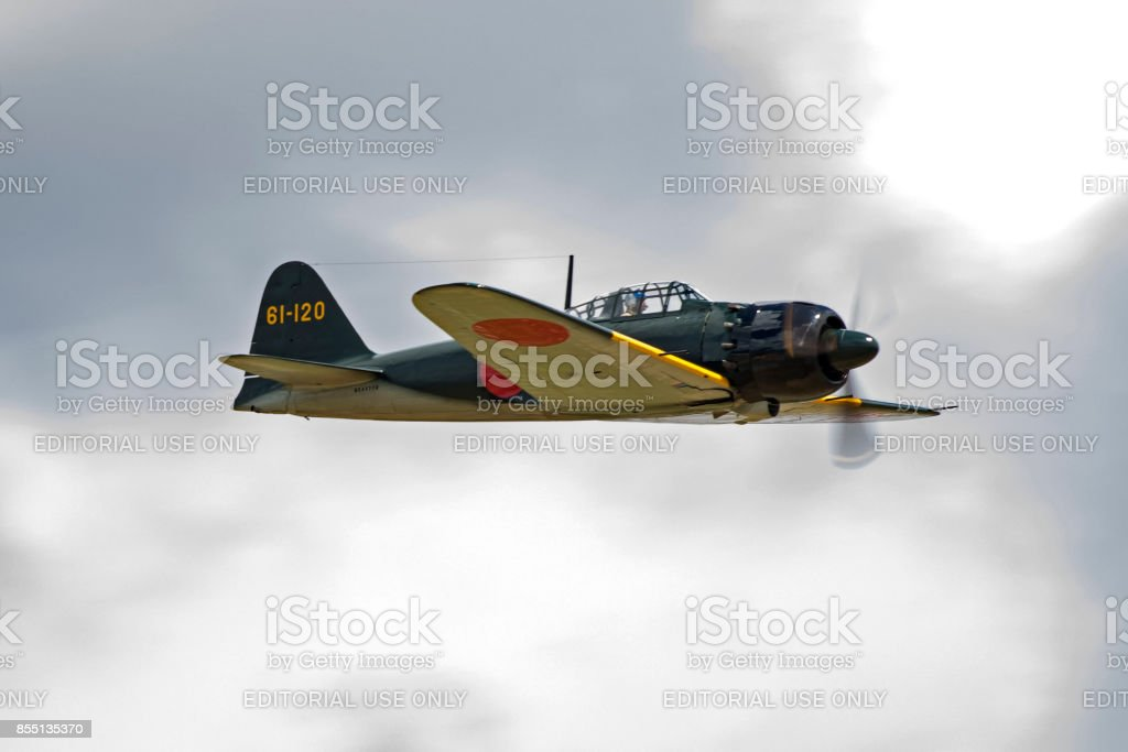 Airplane Mitsubishi Zero fighter aircraft flying at the airshow stock photo