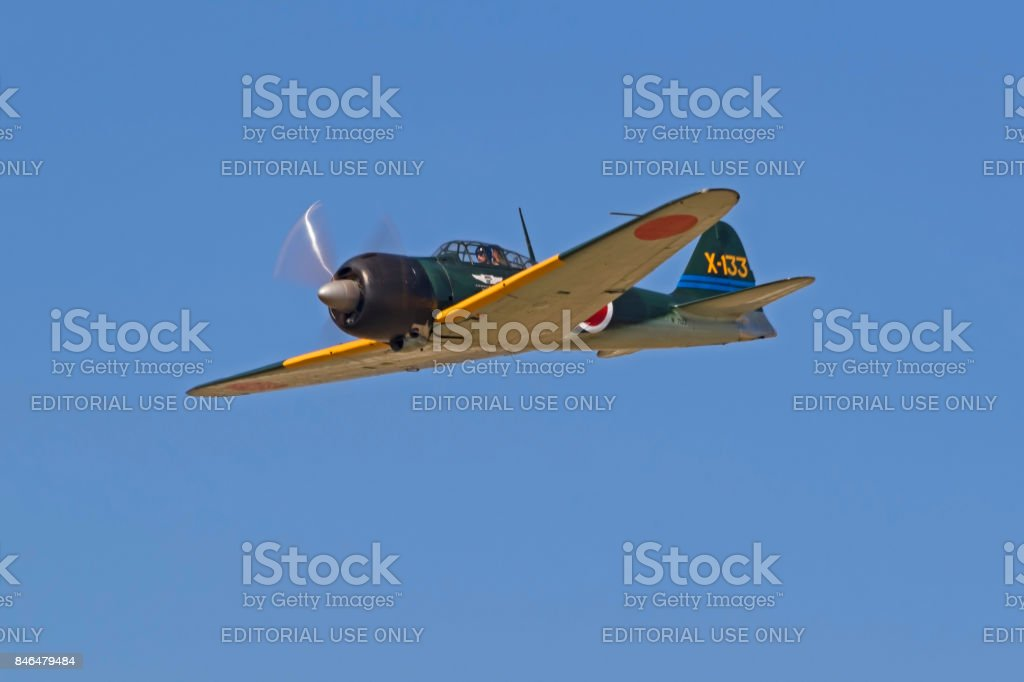Airplane Mitsubishi Zero WWII fighter flying at the airshow stock photo