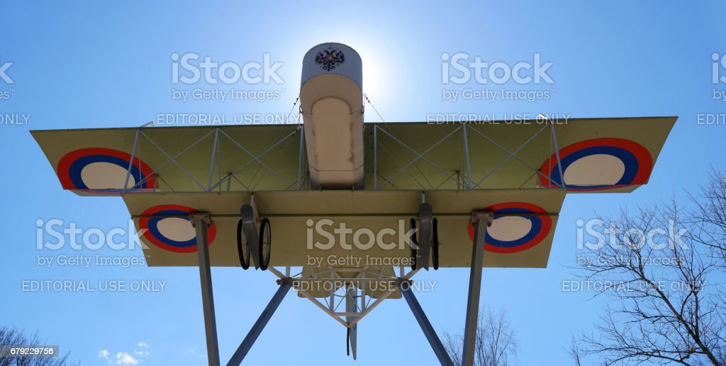 Airplane model Foreman in the form of a monument. Photographed in backlight. stock photo