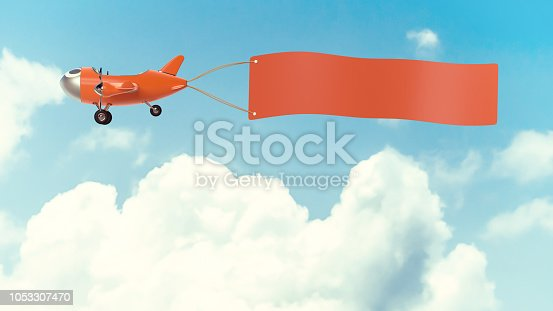 istock Airplane model orange  color with empty banner mock-up 1053307470