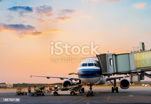 186763256 istock photo Airplane near terminal 186763196