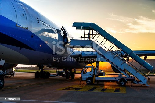 186763256 istock photo Airplane near the terminal in an airport 184668455