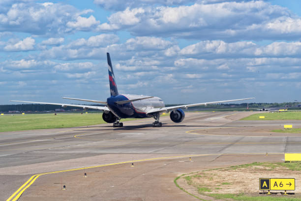 Airplane of Aeroflot airline is waiting for take off on runway, Sheremetyevo international airport, Moscow stock photo