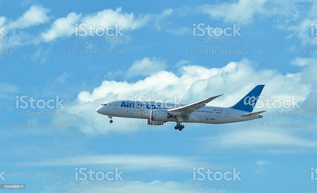 airplane of Air Europa flying in clouds - Boeing 787 stock photo