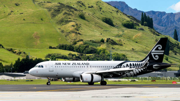Airplane of Air New Zealand takes off from airport stock photo