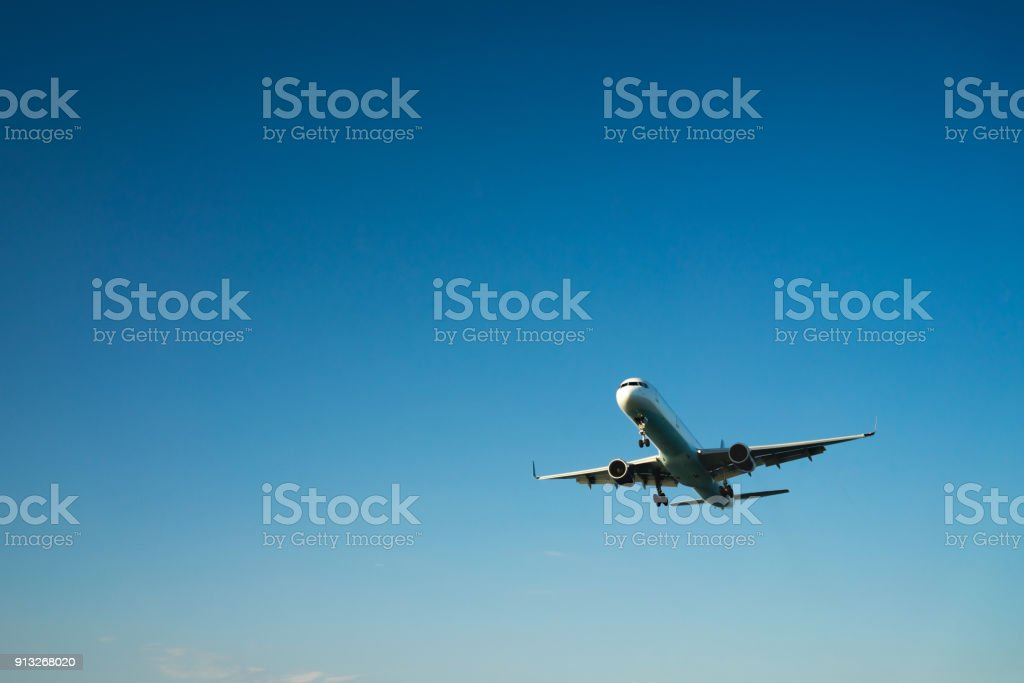 airplane on a blue background stock photo