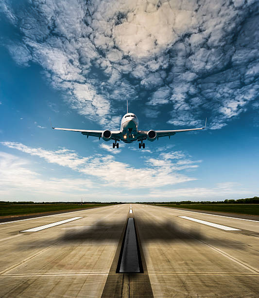 Airplane on a sunny day  Jet airplane landing on runway airfield stock pictures, royalty-free photos & images