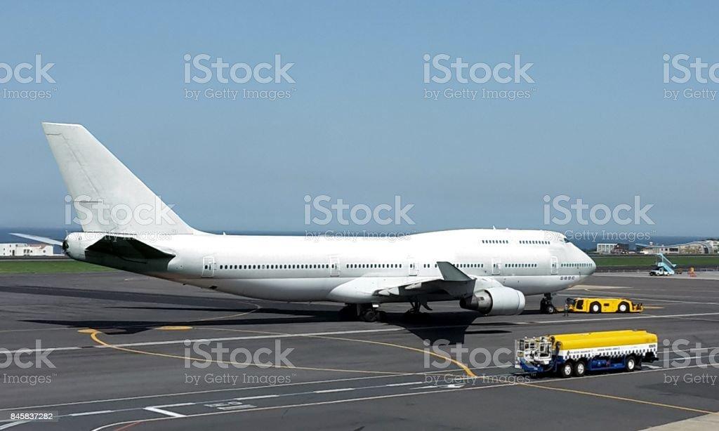 Airplane on airport ground stock photo