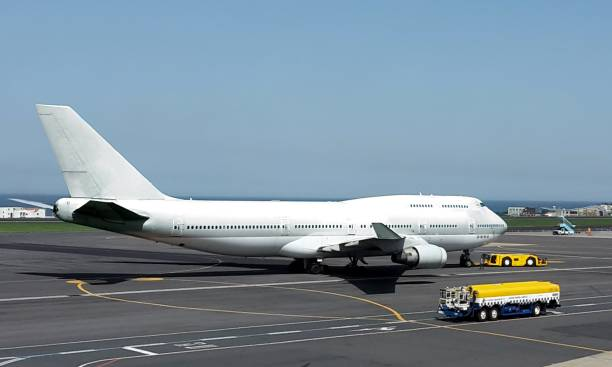 airplane on airport ground - stranded stock pictures, royalty-free photos & images