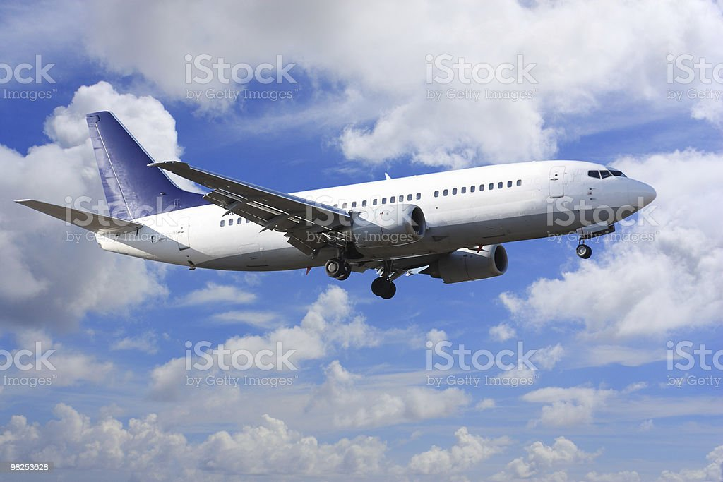 airplane on clouds royalty-free stock photo