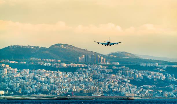 airplane on final approach to beirut international airport, lebanon - beirut стоковые фото и изображения
