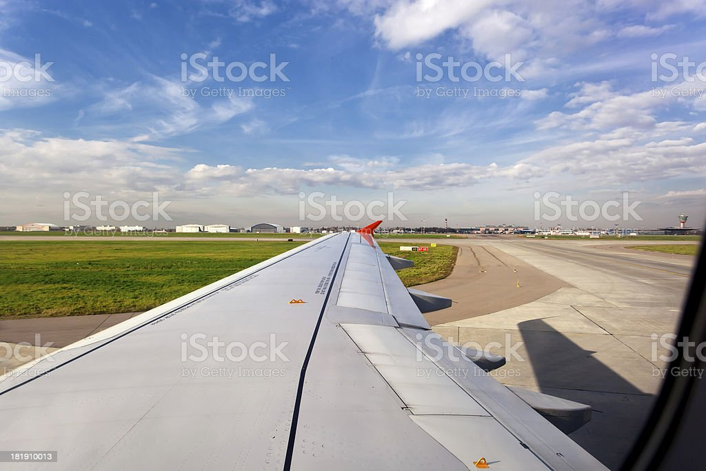 Airplane on landing strip royalty-free stock photo