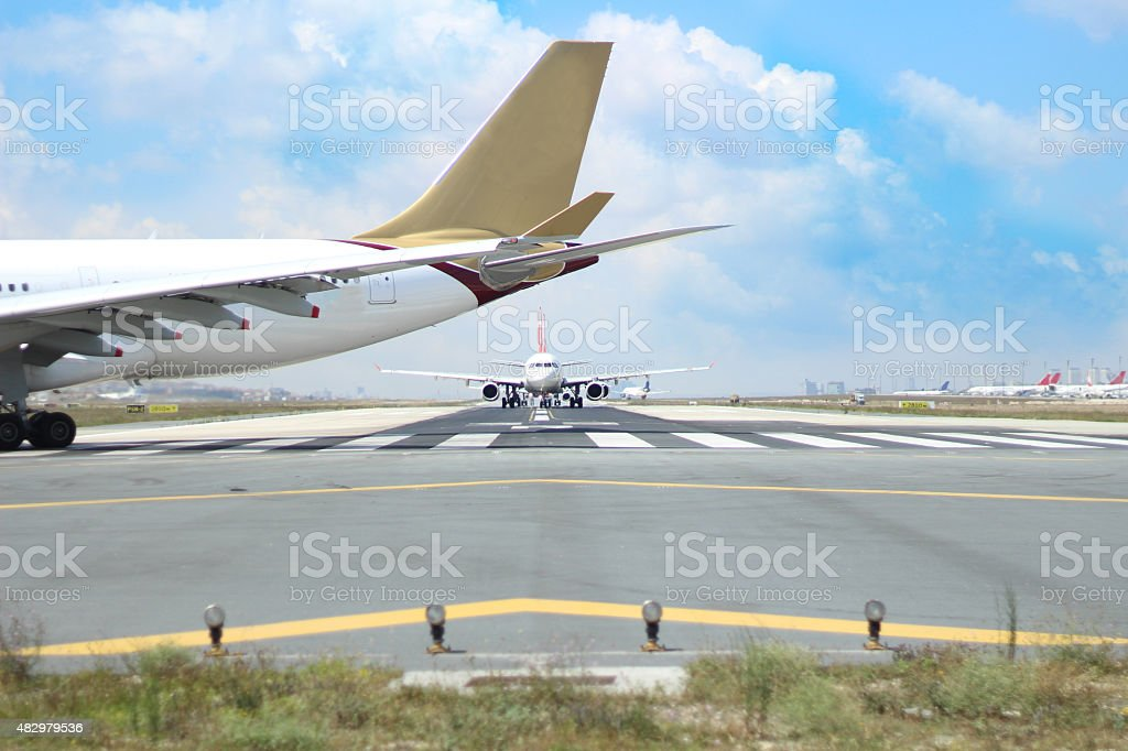airplane on runway stock photo