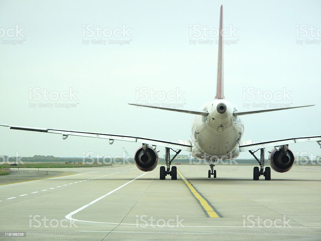 airplane on runway ready for take off royalty-free stock photo