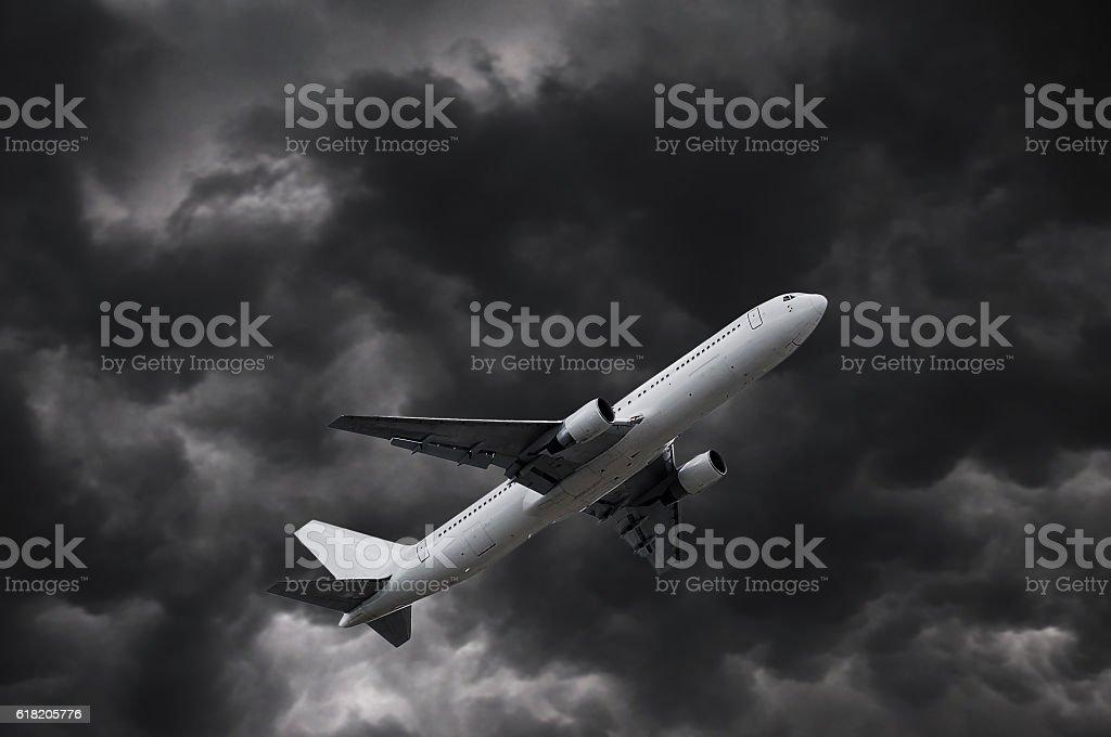 airplane on stormy sky stock photo