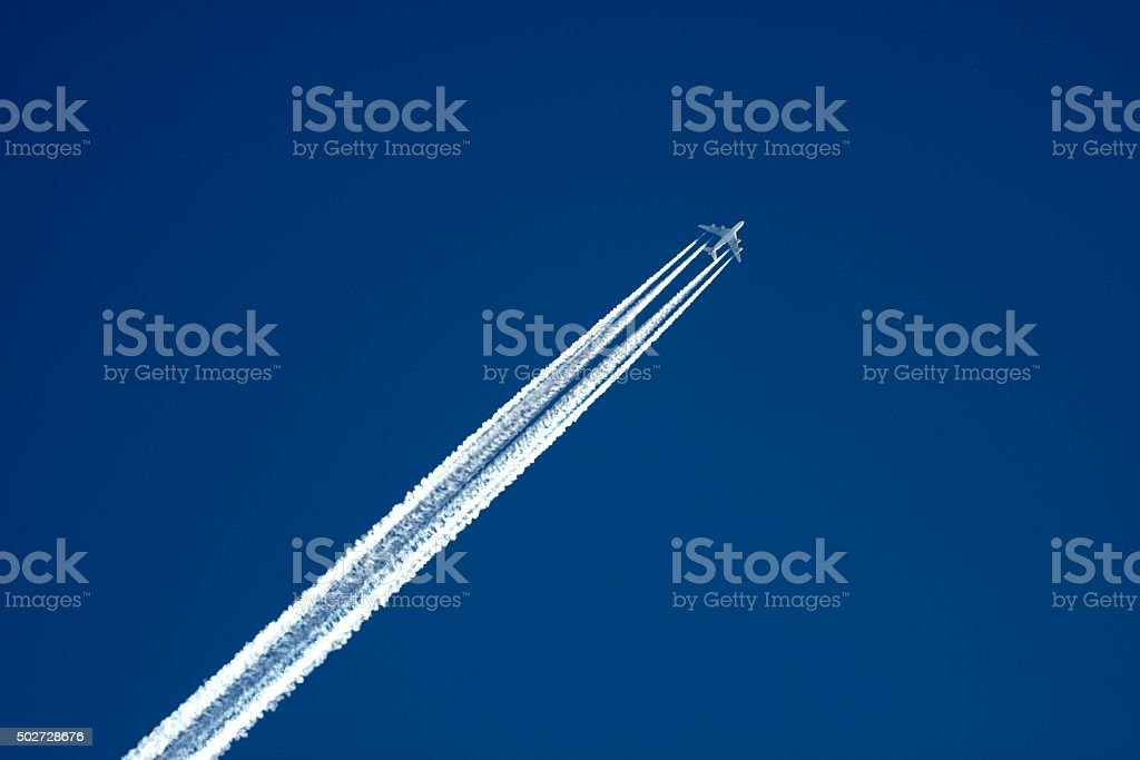 Airplane on the clear blue sky stock photo