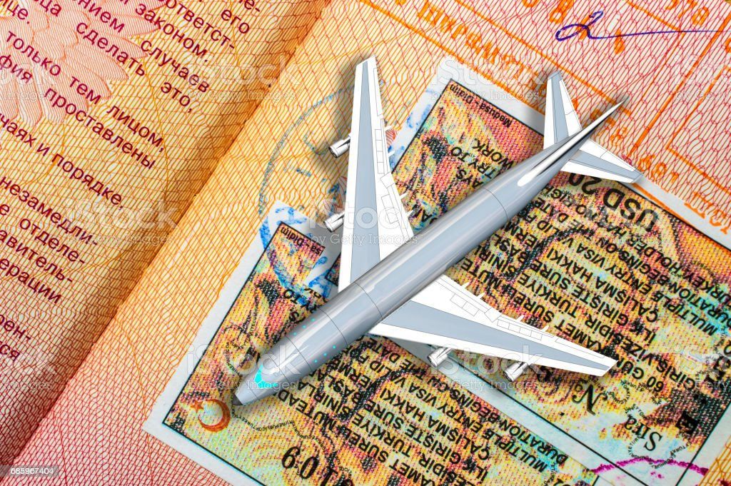Airplane on the page of a foreign passport, the concept of travel stock photo