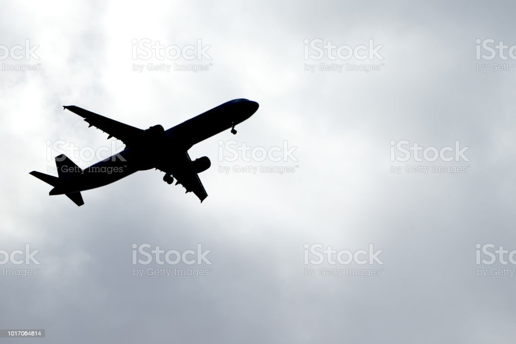 Airplane on the sky silhouette stock photo