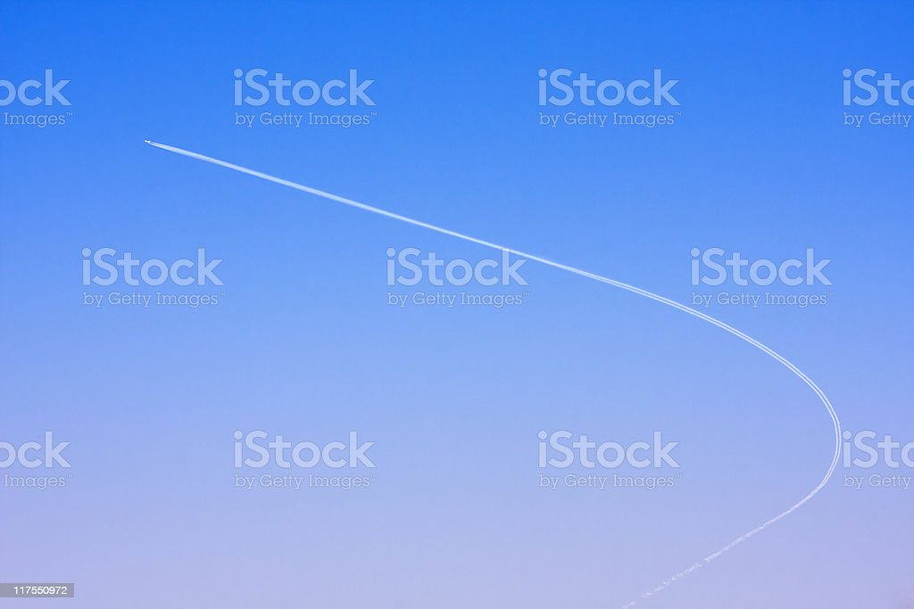 Airplane over a bright blue sky royalty-free stock photo