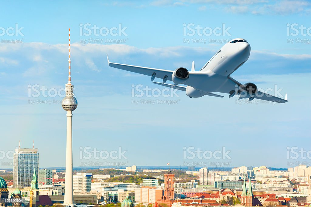 Airplane over Berlin royalty-free stock photo
