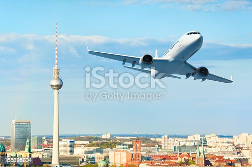 istock Airplane over Berlin 155395604