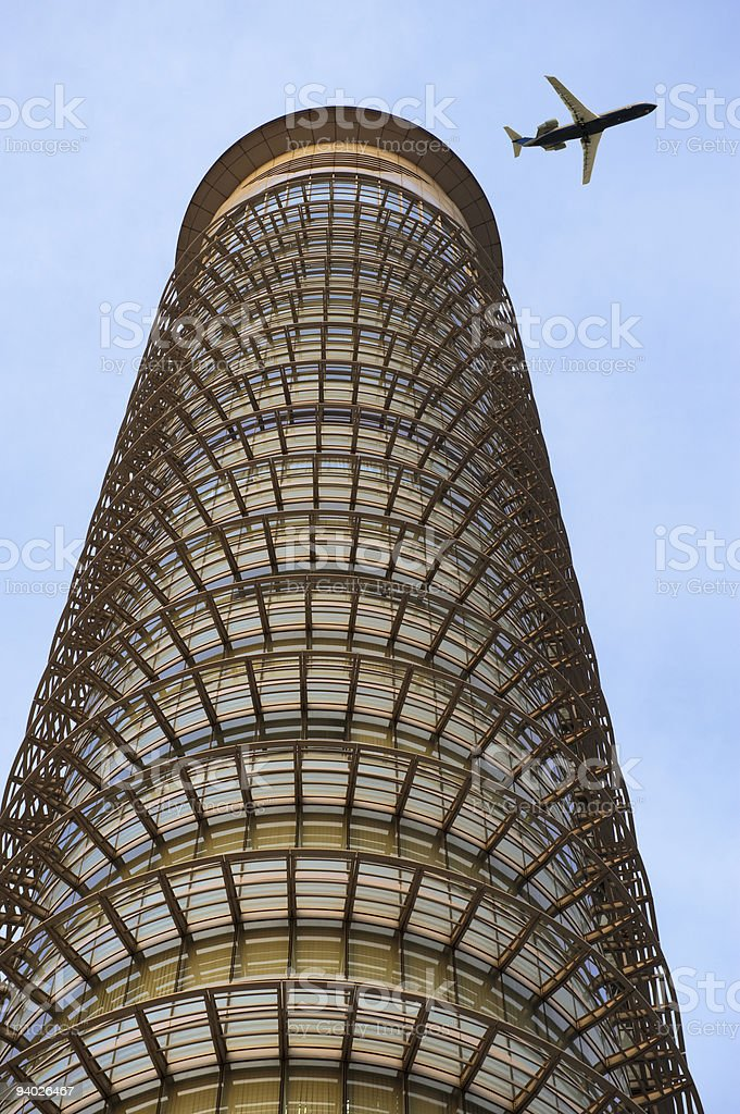 airplane over buildings royalty-free stock photo