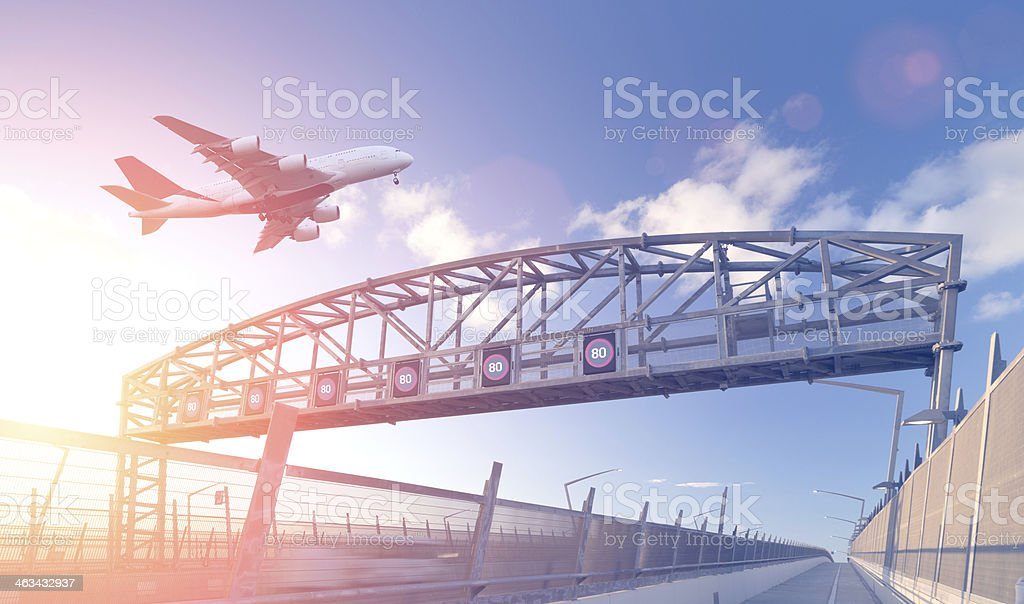 Airplane over freeway stock photo