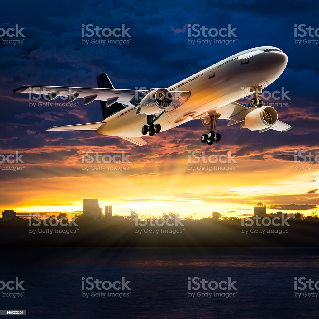 Airplane over river stock photo