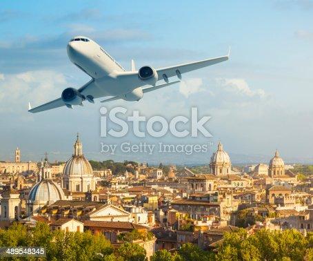 istock Airplane over Rome 489548345
