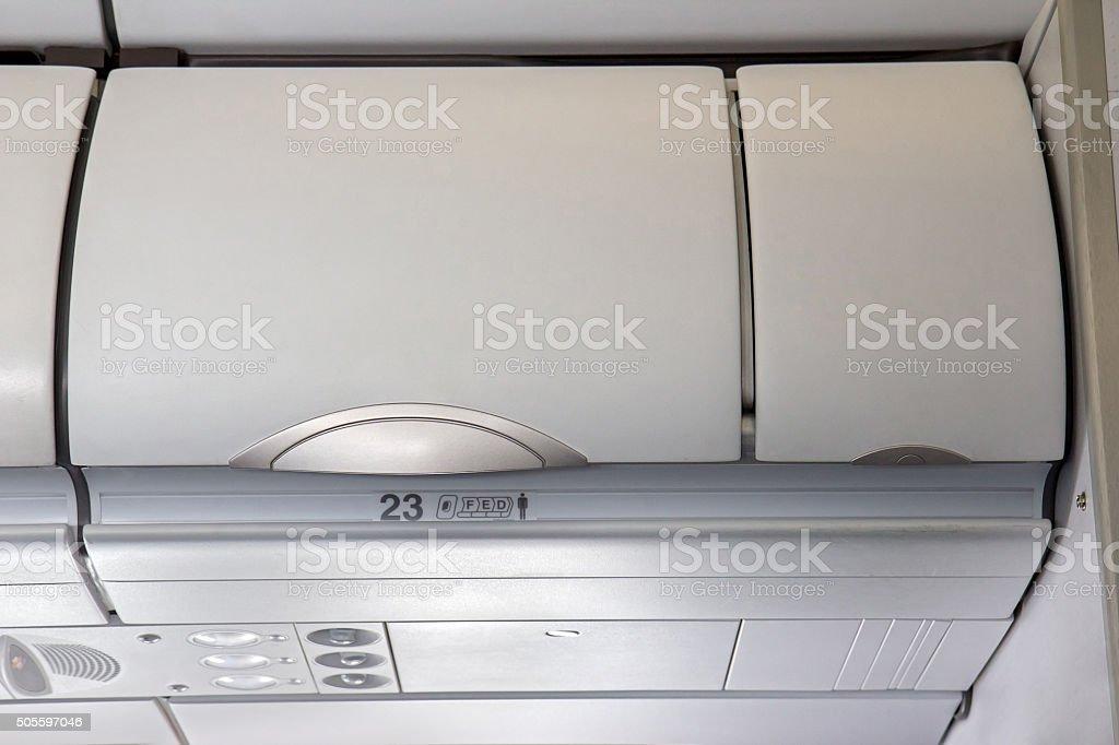 airplane overhead stowage stock photo