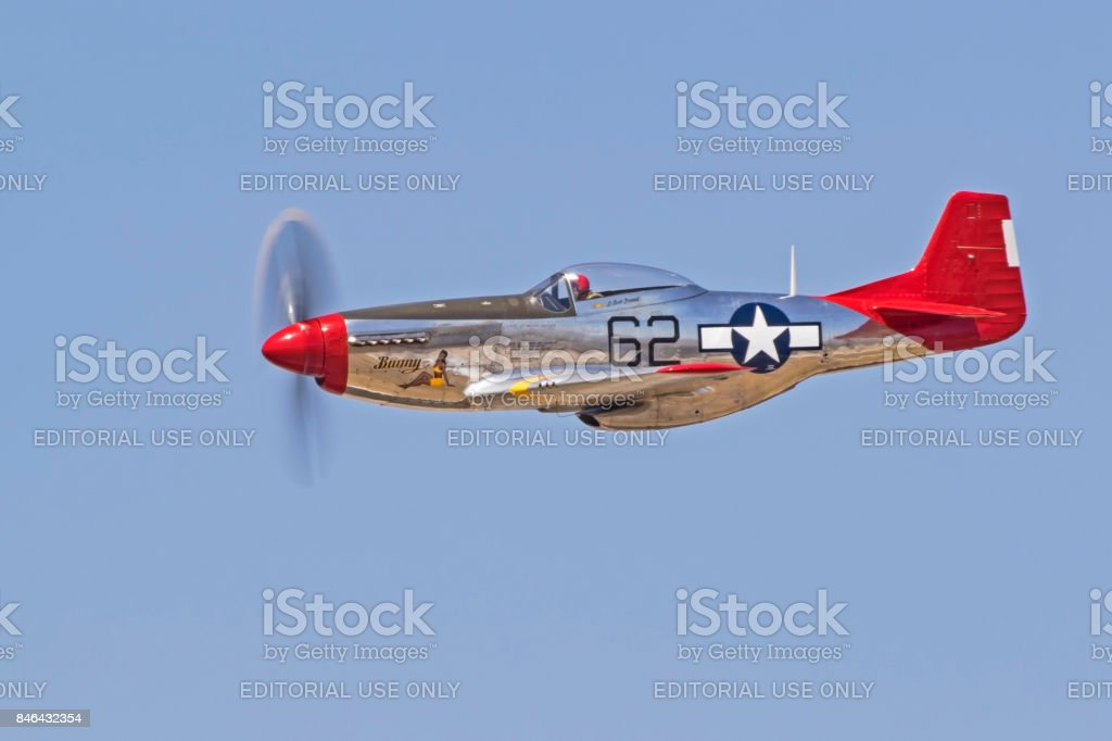 Airplane P-51 Mustang Red Tail aircraft flying at the airshow stock photo